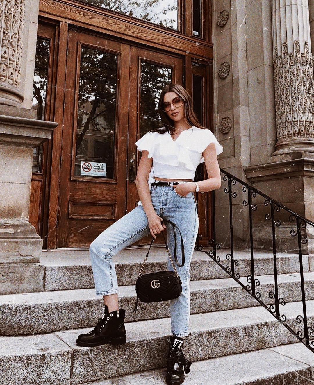 Ruffled White Crop Top And Wash Blue Jeans With Black Combat Boots For Spring 2019