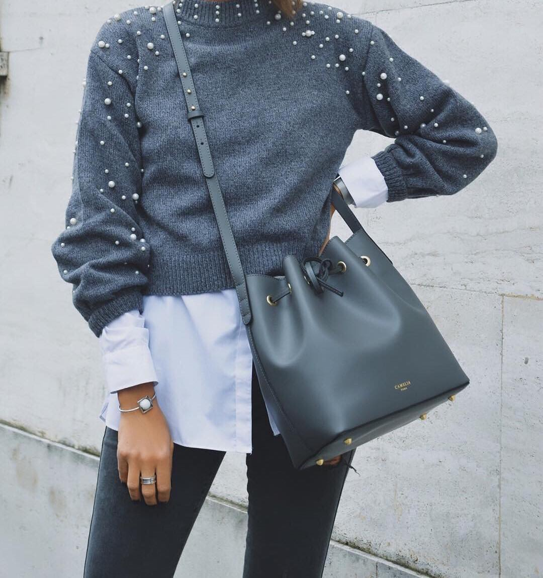 Grey Sweater Embellished With White Pearls And Dark Grey Skinny Jeans For Fall 2019