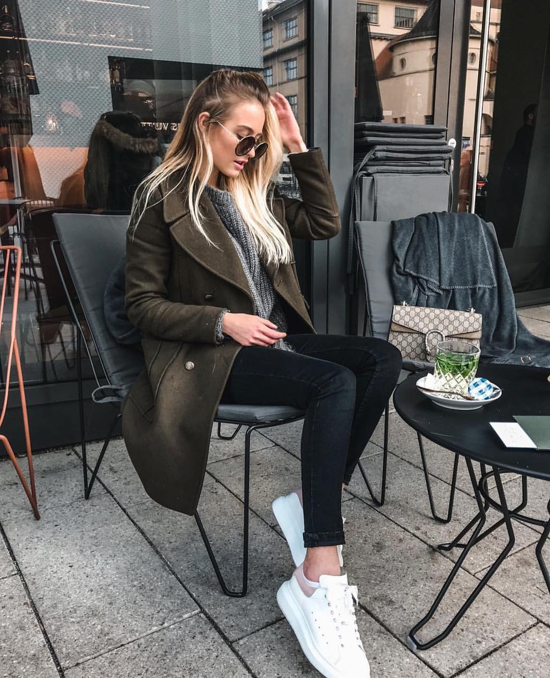 Dark Green Wool Coat With Grey Sweater, Black Skinnies And White Sneakers For Fall 2019