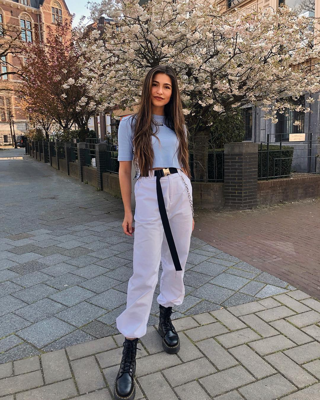 Pastel Blue Top With White Jogger Pants And Black Combat Boots For Summer 2019